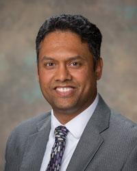 Dr. Amit Acharya